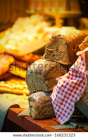 Bread or loafs on display in a christmas setting at a market in Stockholm, Stortorget - stock photo