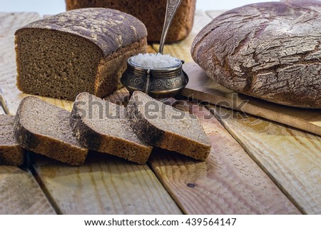 Bread rye  on an old wooden table - stock photo