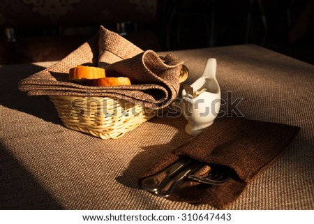 bread, sauce and cutlery are on the table in a cafe - stock photo