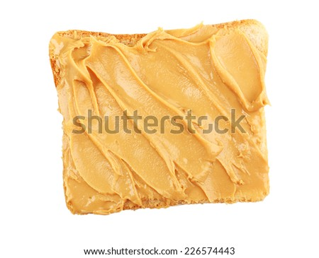 Bread slice with creamy peanut butter, isolated on white - stock photo