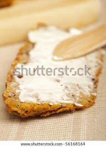 bread slices on a board with a knife - stock photo