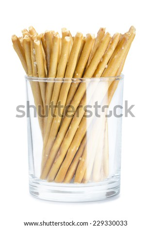 Bread sticks in a glass on a white background - stock photo