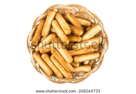 Bread sticks with salt in wicker basket isolated on white background. Top view - stock photo