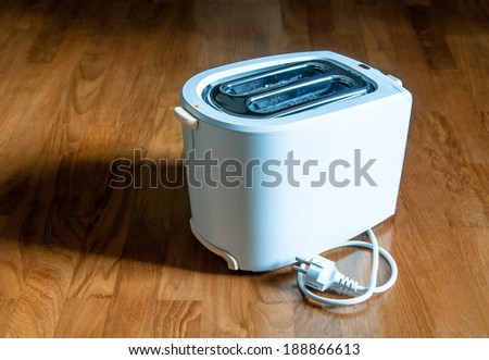 bread toaster on wooden background - stock photo