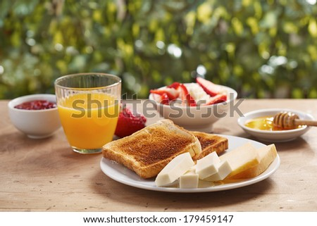 Bread toasts for breakfast in outdoor table - stock photo