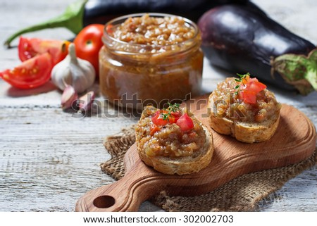 Bread toasts with eggplant caviar. Selective focus - stock photo