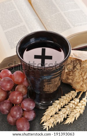 Bread, wine and bible for sacrament or communion - stock photo