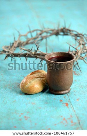 Bread, wine and crown of thorns as symbols of communion - stock photo