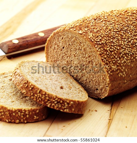 Bread with a few slices - stock photo
