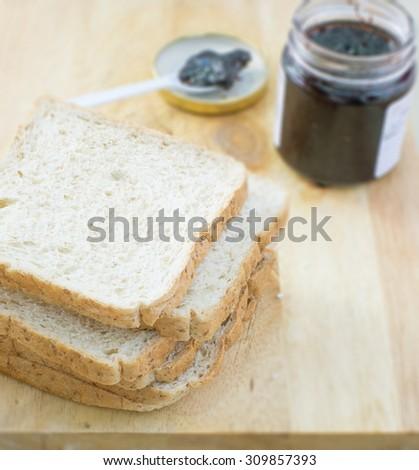 bread with blueberry jam - stock photo