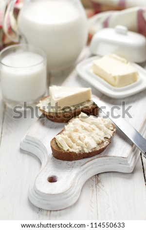Bread with cream cheese for breakfast - stock photo