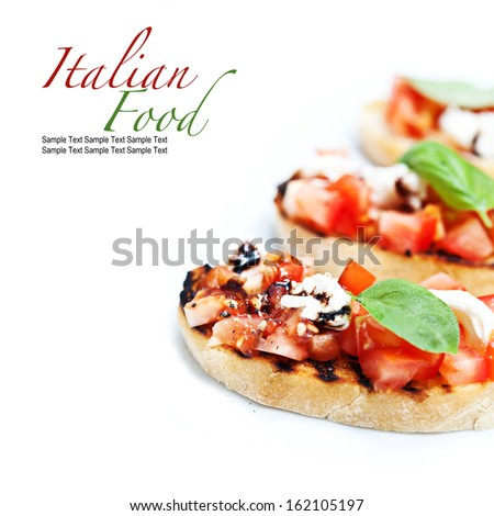 Bread with fresh tomatoes, cheese and basil - stock photo