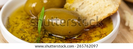 Bread with olive oil. Panoramic image. Selective focus. - stock photo