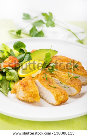 breaded chicken fillet with salad - stock photo