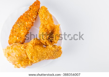 breaded chicken legs with fried potatoes - stock photo