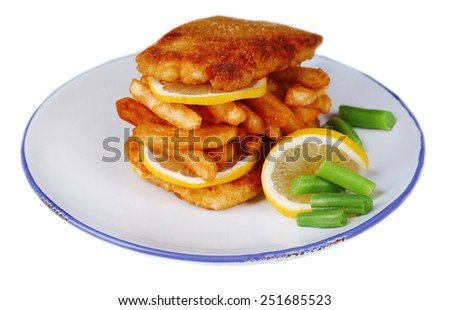 Breaded fried fillet and potatoes with asparagus and sliced lemon on plate isolated on white - stock photo