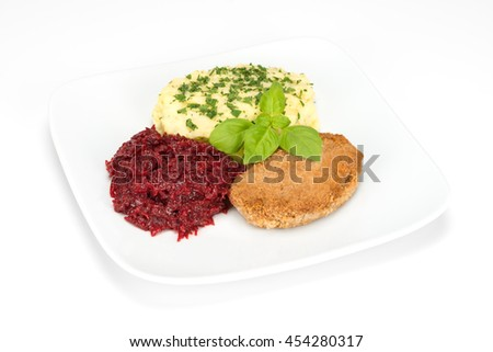 breaded pork chop with puree and beets on the plate isolated on white background - stock photo