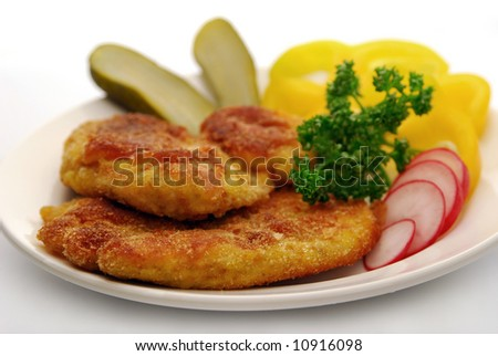 Breaded steak and vegetable garnish - stock photo