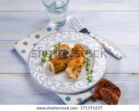 breaded swordfish stuffed with dried tomatoes - stock photo