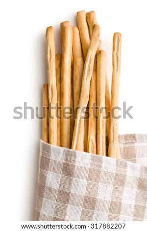 breadsticks grissini on white background - stock photo