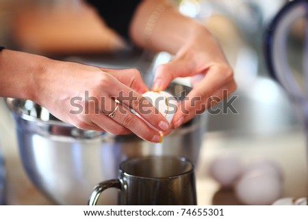 break an egg by cup - stock photo