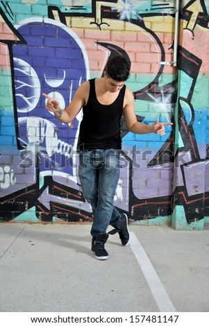 break-dance dancer on a city street posing with a dance move - stock photo