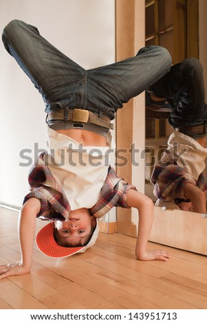 Break dancing. Breakdance near mirror - stock photo