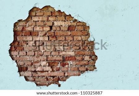 Break on the white wall - old brickwork - stock photo