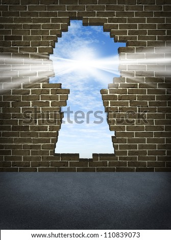 Break through and the solution or answer to success as a breaking down walls concept for business or a free your mind icon with an old urban brick wall with a damaged hole in the shape of a key hole. - stock photo