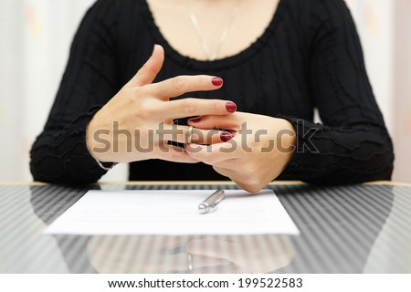 break up . Woman is taking off the ring from hand - stock photo