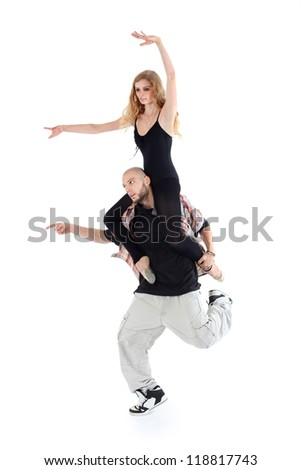 Breakdancer keeps on shoulders ballerina isolated on white background. Man and woman point to left. - stock photo