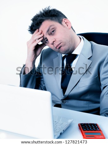 breakdown of charming businessman at the office - stock photo