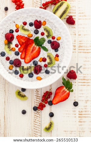 Breakfast bowl: coconut chia pudding with fruits and berries. - stock photo
