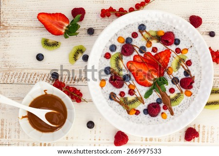 Breakfast bowl: coconut chia pudding with fruits, berries and nut butter - stock photo