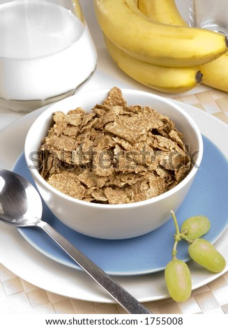 Breakfast Bran Flakes with grapes and bananas - stock photo
