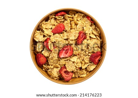 Breakfast cereal with flakes of dried raspberry. Selective focus. - stock photo