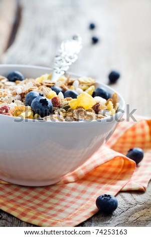 Breakfast cereal with fresh blueberries, selective focus - stock photo