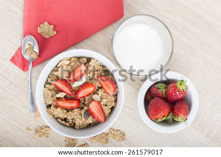 Breakfast, cereal with fresh strawberries and milk - stock photo