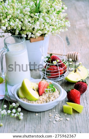 Breakfast cereal with strawberries and milk, healthy food - stock photo