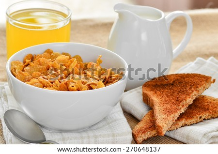 Breakfast cereal with toast and juice. - stock photo
