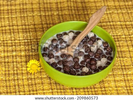 Breakfast cereals, chocolate balls with milk - stock photo