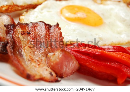 Breakfast - egg, bacon and vegetables (shallow DOF) - stock photo