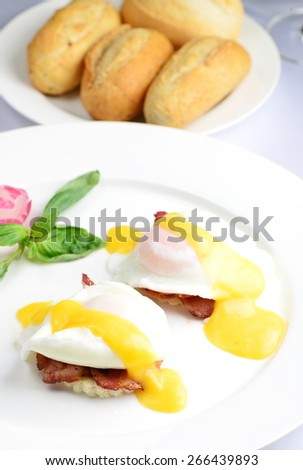 Breakfast, Eggs Benedict- toasted English muffins, ham, poached eggs, and delicious buttery hollandaise sauce - stock photo