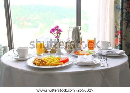 Breakfast for two served in a hotel room - stock photo