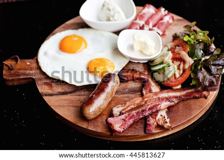Breakfast - fried egg with bacon and cheese - stock photo
