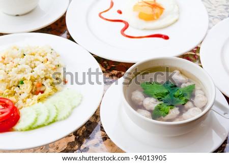 Breakfast - fried rice,soup,toast,egg - stock photo