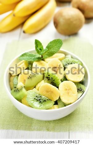 Breakfast fruit salad from kiwi and banana - stock photo