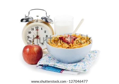 Breakfast in a bowl with alarm clock displayed on white. - stock photo