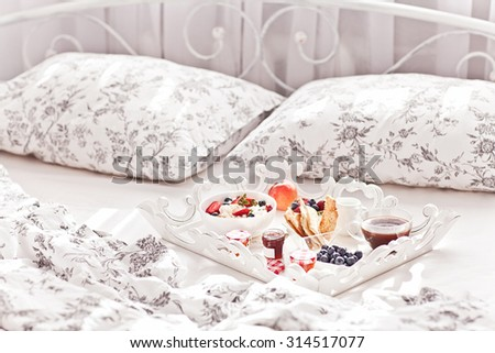 Breakfast in Bed. Cottage Cheese, coffee, berries, cookies and jam. Sweet morning. - stock photo