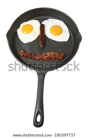 Breakfast in skillet in shape of a face on white background - stock photo